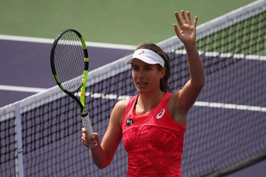 Johanna Konta of Great Britain celebrates after her straight sets victory.
