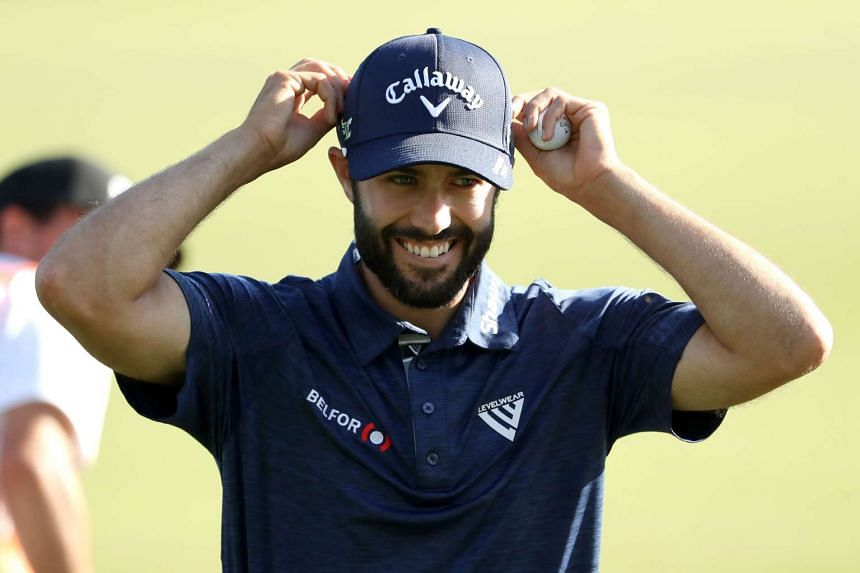 Adam Hadwin of Canada walks off the 18th green as the leader during the second round of the Valspar Championship.