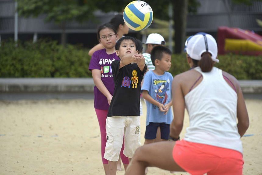 A boy learning how to play Volleyball at the sandpit at Sports Hub as part of Sports Hub Community Play Day at (CPD) on March 11, 2017.