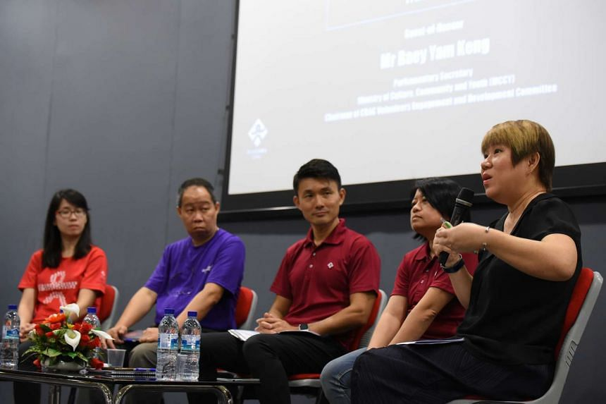 Volunteers with chairman of CDAC Volunteers Engagement and Development Committee Baey Yam Keng (centre) and moderator Lam Moy Yin speaking at a plenary session during the CDAC Volunteer Seminar on March 11, 2017.