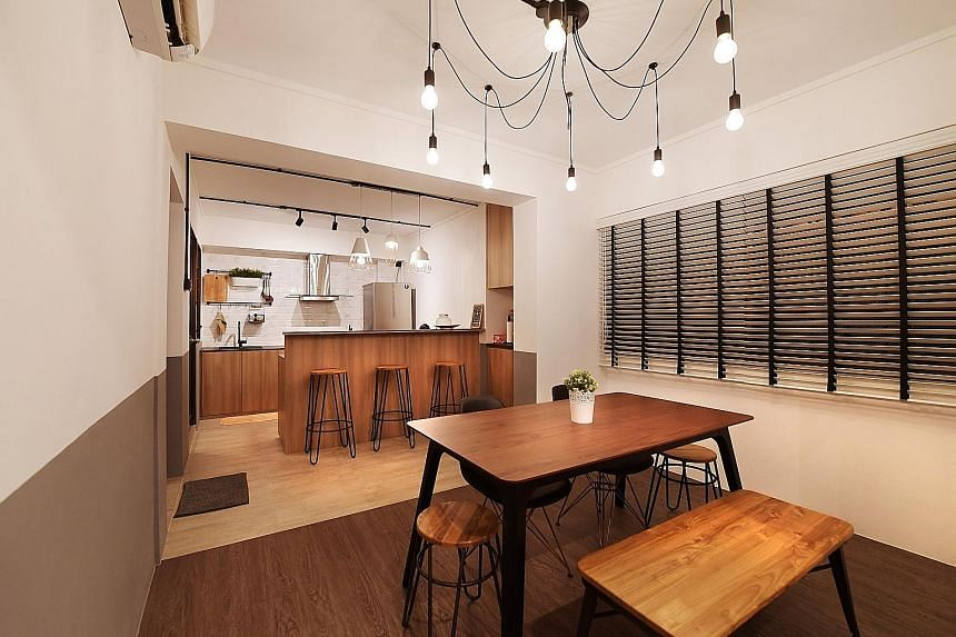 A countertop kitchen with bar stools (above), for extra seating; and an altar fashioned out of a shelf are among the features in the home of Mr Daniel Kor and Ms Lim Shuhui.