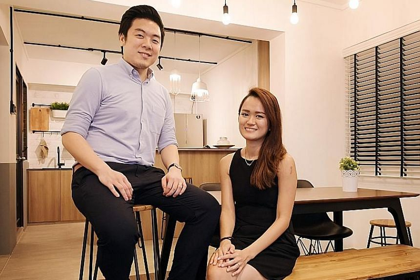 A countertop kitchen with bar stools, for extra seating; and an altar fashioned out of a shelf are among the features in the home of Mr Daniel Kor and Ms Lim Shuhui (both above).