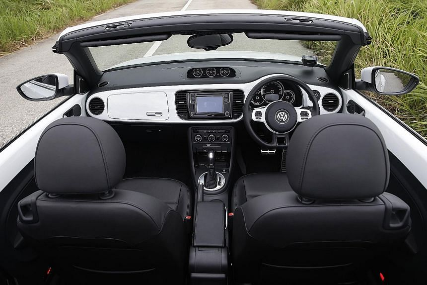 The Beetle Cabriolet's Fender hi-fi system works well with the top down and the car's cockpit (far left) is a tribute to the iconic car baby boomers grew up with.