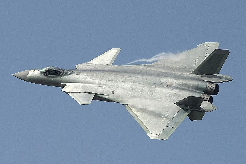 The J-20 stealth fighter on show for the first time in November at the Zhuhai air show. Questions remain on whether it can match the radar-evading properties of the US F-22 Raptor combat jet.