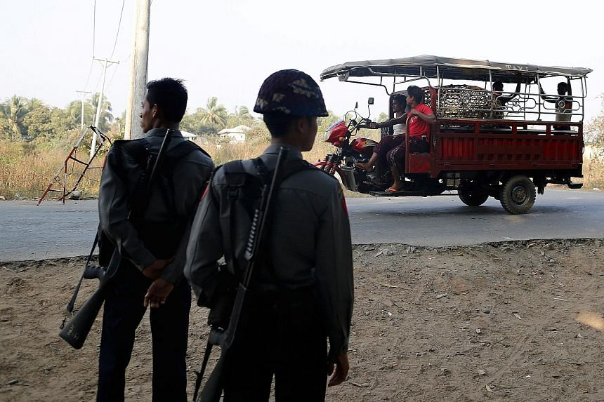 Myanmar police officers at a checkpoint outside a Rohingya refugee camp in Sittwe on March 3. Rakhine state has been plagued by insurgent attacks as well as a military retaliation that may constitute ethnic cleansing.
