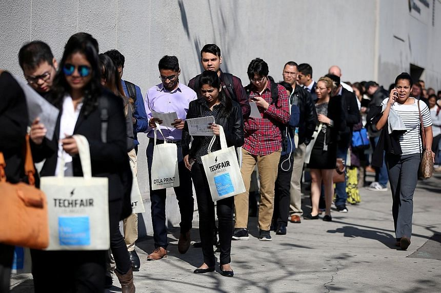 Jobseekers at the TechFair LA, a technology job fair in Los Angeles. In another sign of a tightening labour market, the already low unemployment rate fell a tenth of a point to 4.7 per cent and wages grew 2.8 per cent.