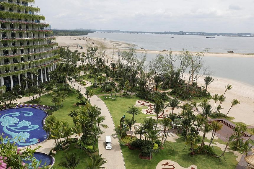 """Land reclamation next to a hotel in Country Garden's Forest City project in Johor Baru. The company says it is overhauling its Chinese sales centres """"to better fit with current foreign exchange policies and regulations"""", and as part of its shift to a"""