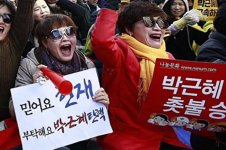 Scenes of jubilation and despair after the Constitutional Court in Seoul, in a unanimous decision, upheld President Park Geun Hye's impeachment yesterday. The top court's ruling, which was televised live, marks the downfall of the country's first fem