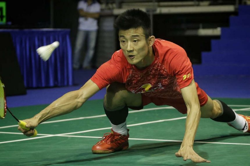 China's Olympic champion Chen Long lost in the second round to Thailand's Tanongsak Saensomboonsuk in the All England Open.