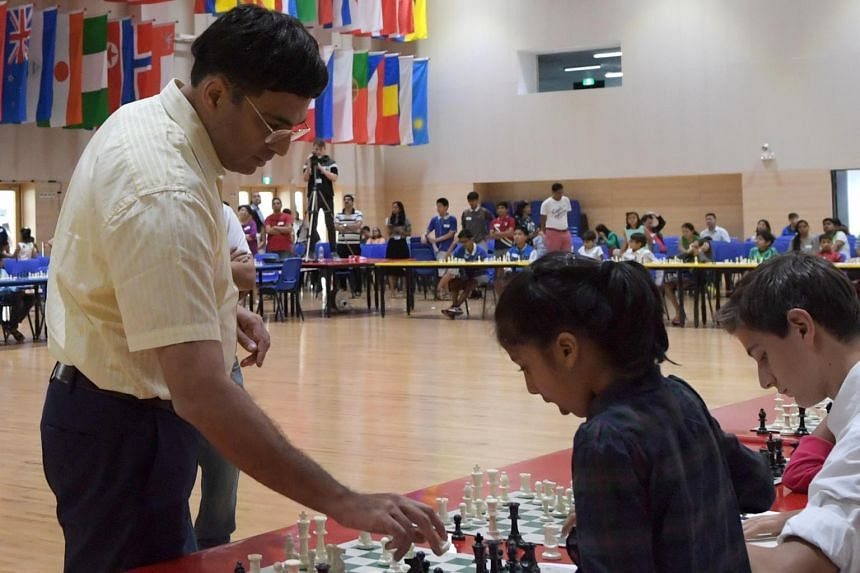 Five-time World Champion Viswanathan Anand plays an Exhibition Chess Match against 50 Singapore school children at the Overseas Family School on March 11, 2017.