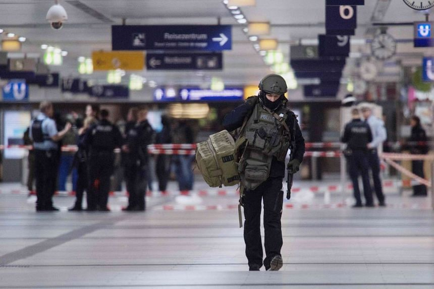 Police at the main train station in the German city of Dusseldorf.