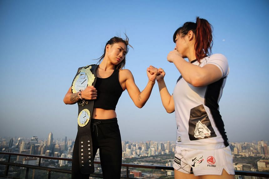 One Championship's Angela Lee (left) and Jenny Huang going toe to toe at the Banyan Tree Bangkok's Vertigo and Moon Bar. Their title fight will anchor today's One: Warrior Kingdom, with atomweight belt holder Lee looking to send the Chinese Taipei fighter