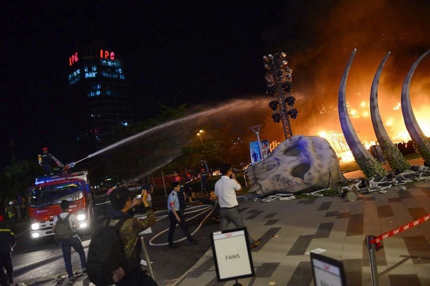 A firefighter truck injecting water to control a fire on a giant model of King Kong during the premiere of the Kong: Skull Island in Ho Chi Minh City on March 9, 2017.