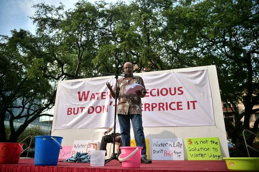 Dr Paul Tambyah, a professor in medicine and an SDP council member, speaks during the water price hike protest at Hong Lim Park on March 11, 2017.