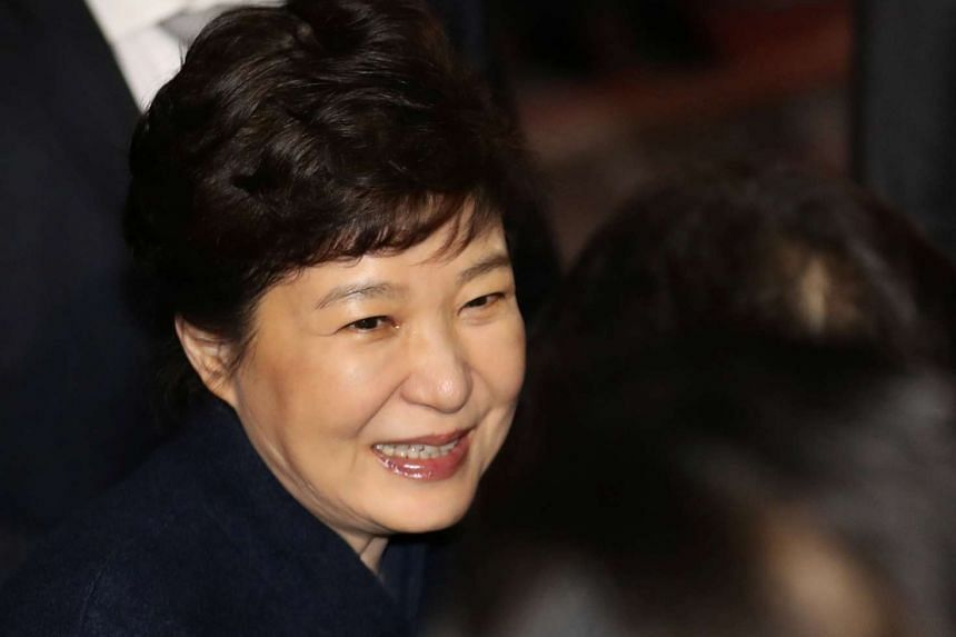 South Korea's ousted leader Park Geun Hye arrives at her private house in Seoul, on March 12, 2017