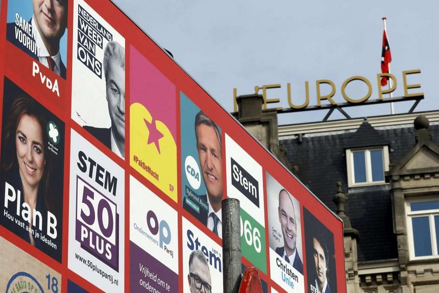 Election campaign posters seen on a hoarding in Amsterdam, Netherlands, on March 11, 2017.