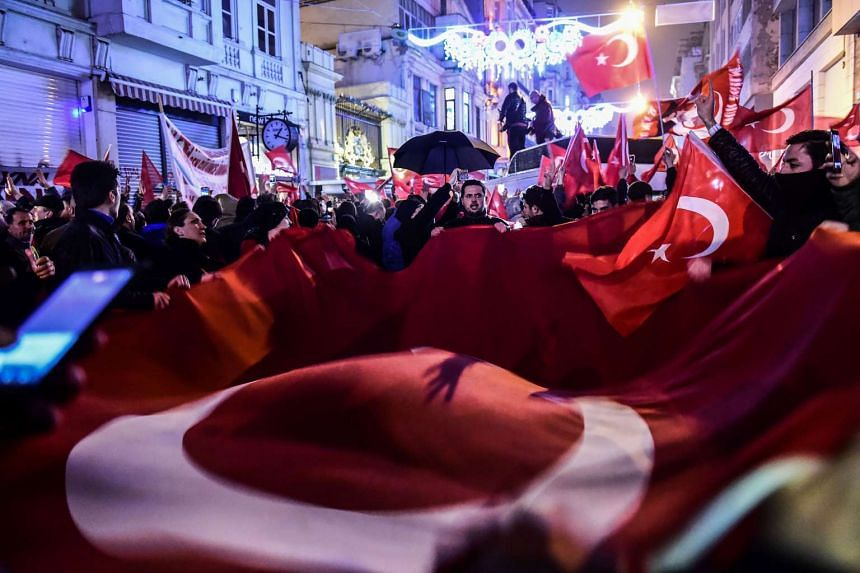 Protestors waving Turkish flags during a demonstration in front of the consulate of the Netherlands in Istanbul on March 11, 2017.
