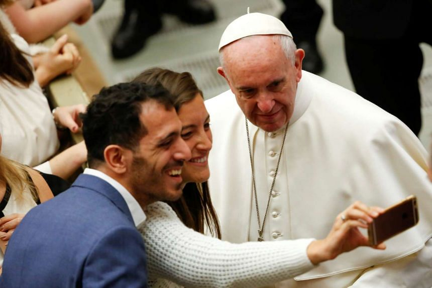 Vatican visitors take a selfie with Pope Francis on Jan 4, 2017.