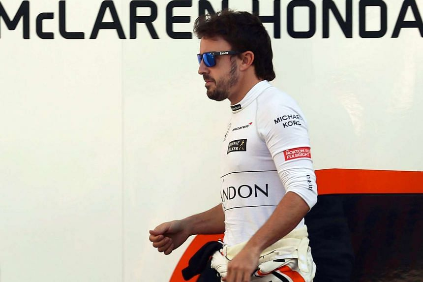 Alonso walks through the paddock during the Formula One pre-season test sessions, March 10, 2017.
