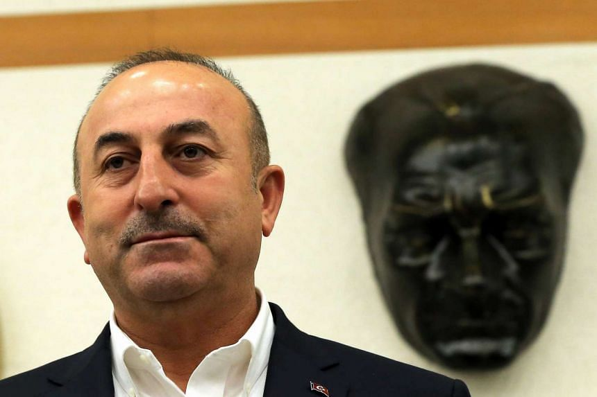 Turkish Foreign Minister Mevlut Cavusoglu speaks during a news conference at Ataturk International airport in Istanbul, Turkey, March 11, 2017.