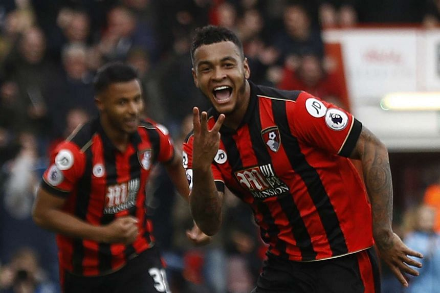 Bournemouth's Joshua King celebrates scoring their third goal to complete his hat-trick.