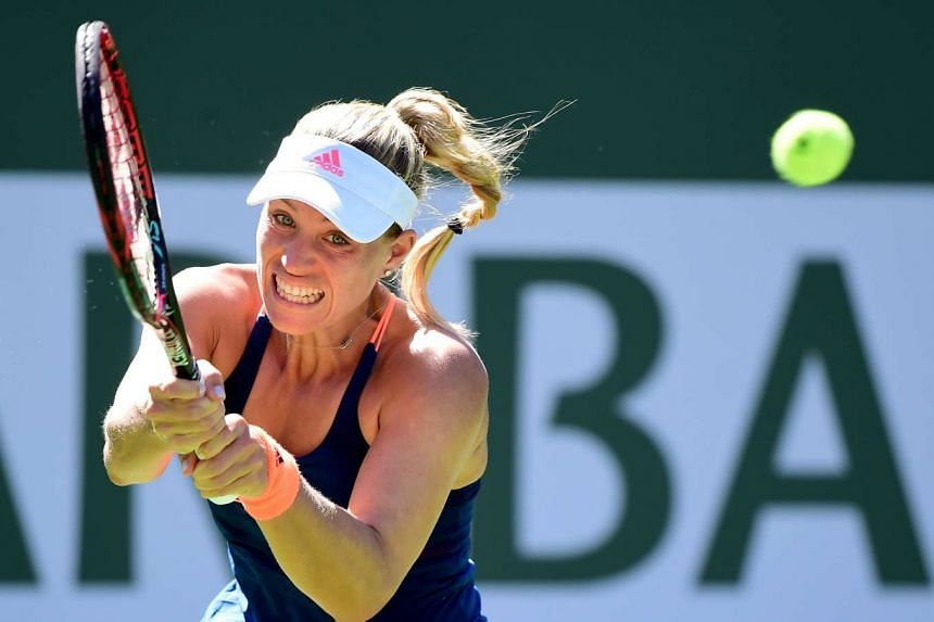 Angelique Kerber of Germany hits a backhand during her straight set win over Andrea Petkovic.