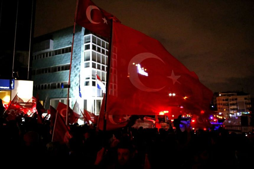 Supporters of Turkish President Recep Tayyip Erdogan shouting slogans against the Netherlands in front of the Embassy of the Netherlands in Ankara on March 12, 2017.