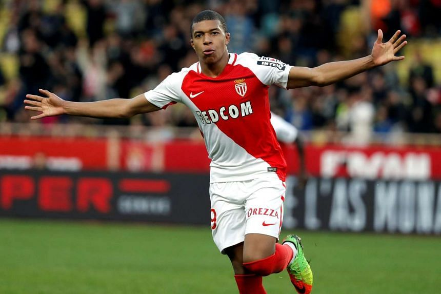 Monaco's Kylian Mbappe celebrating after scoring against Bordeaux during their French Ligue 1 match on March 11, 2017.