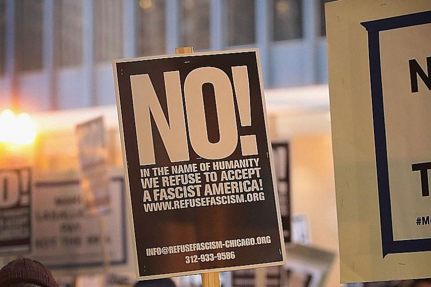 Protesters demonstrating against President Trump in Chicago. Recent analysis shows that support for democracy in the US and Europe has declined over the last 20 years in almost every age group, with the young the most sceptical.
