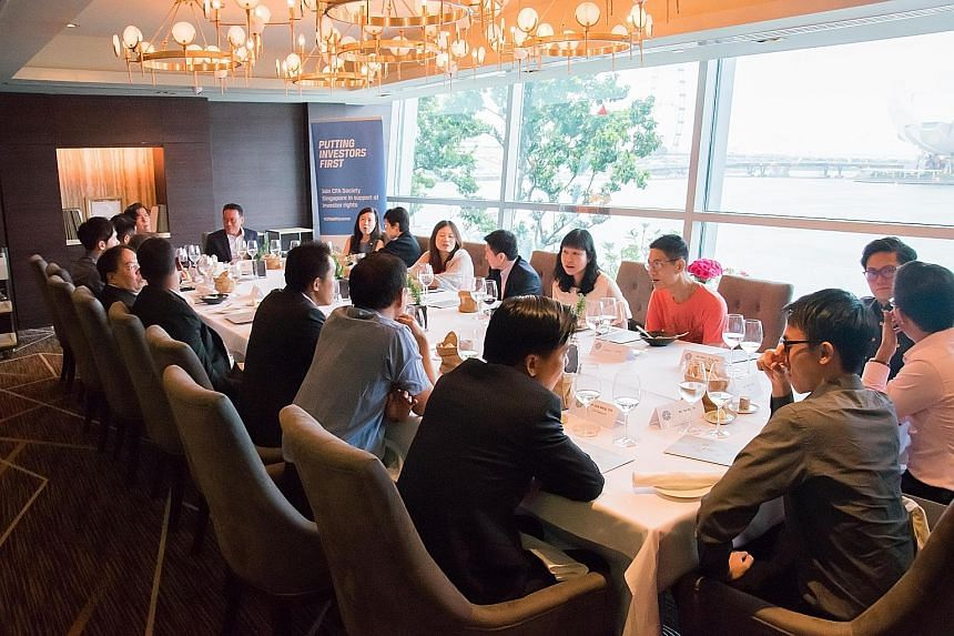 Retail investors who follow the Save & Invest Portfolio Series having lunch with an expert CFA Society Singapore panel and representatives from the Singapore Exchange and The Sunday Times.