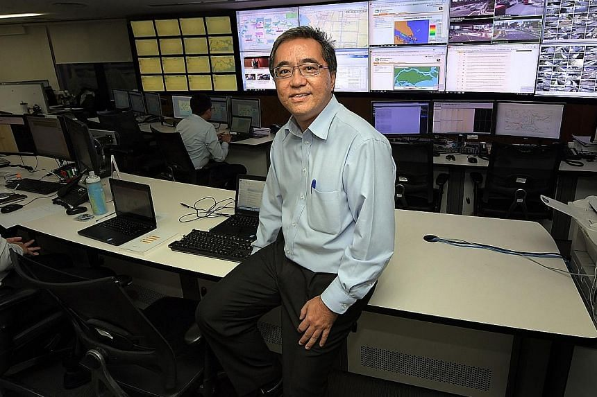 Mr Bernard Koh in the PUB control centre at the Environment Building in Scotts Road. The screens display information on Singapore's water infrastructure in real-time.