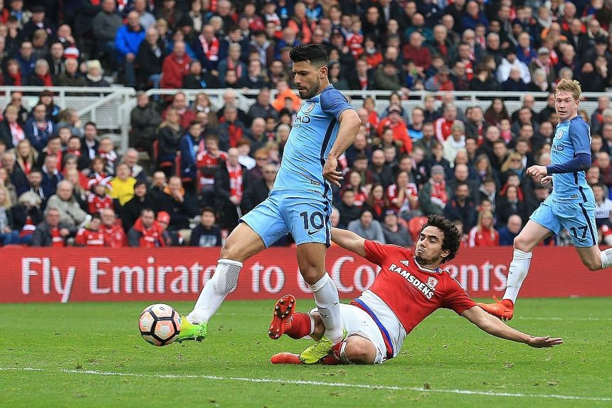 Manchester City's Sergio Aguero evades Middlesbrough defender Fabio da Silva to score his side's second goal off a cross from Leroy Sane in the FA Cup quarter-finals.
