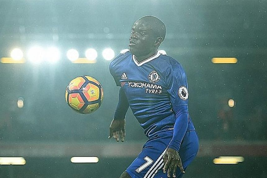 Left: N'Golo Kante does the work of two in Chelsea's midfield. Below: Under the tutelage of Antonio Conte, Eden Hazard is looking like the player who won the PFA Player of The Year award two seasons ago once more.