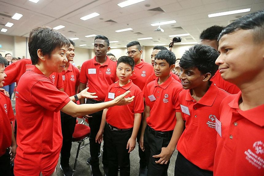 Minister for Culture, Community and Youth Grace Fu speaking to athletes at yesterday's official send-off ceremony for the Special Olympics World Winter Games. Singapore will be represented by 14 athletes - eight floorball players and six speed skater
