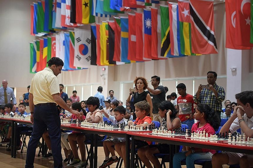 Mr Viswanathan Anand playing in simultaneous chess games against 50 students at Overseas Family School yesterday.