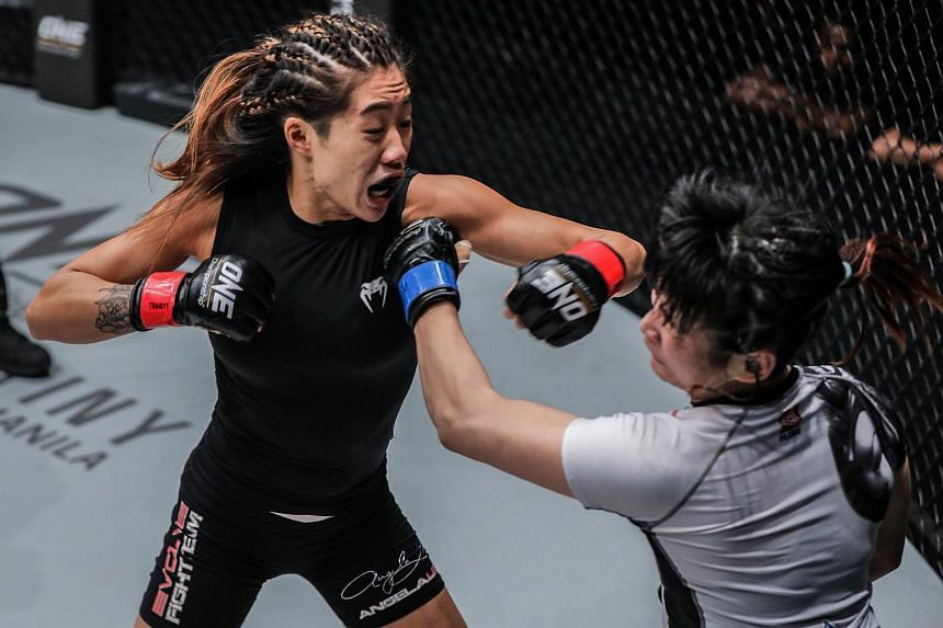 Angela Lee retained her One women's atomweight world championship with a technical knock out win over Jenny Huang.