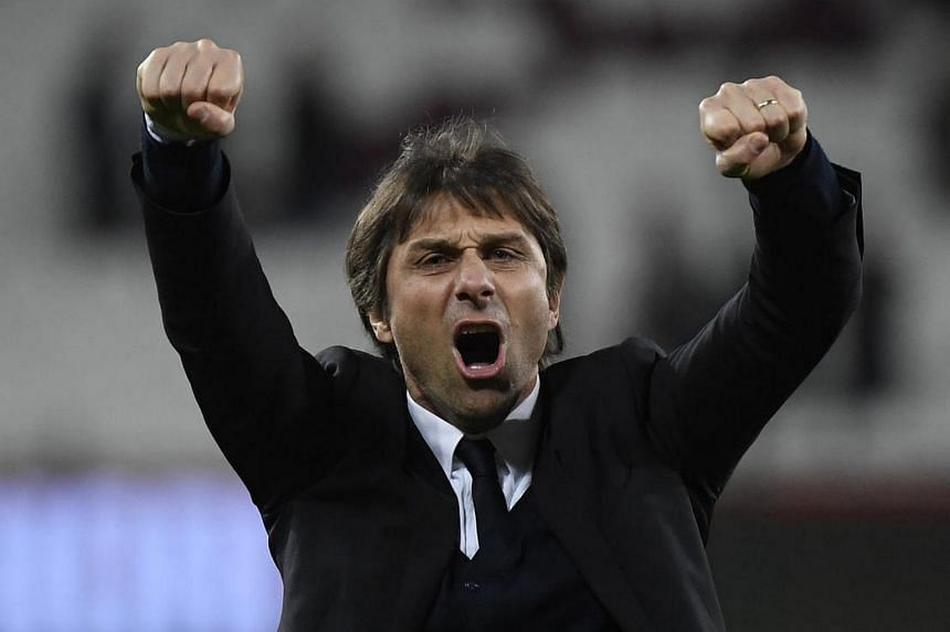 Chelsea manager Antonio Conte celebrates after his team's victory over West Ham United in their Premier League match.