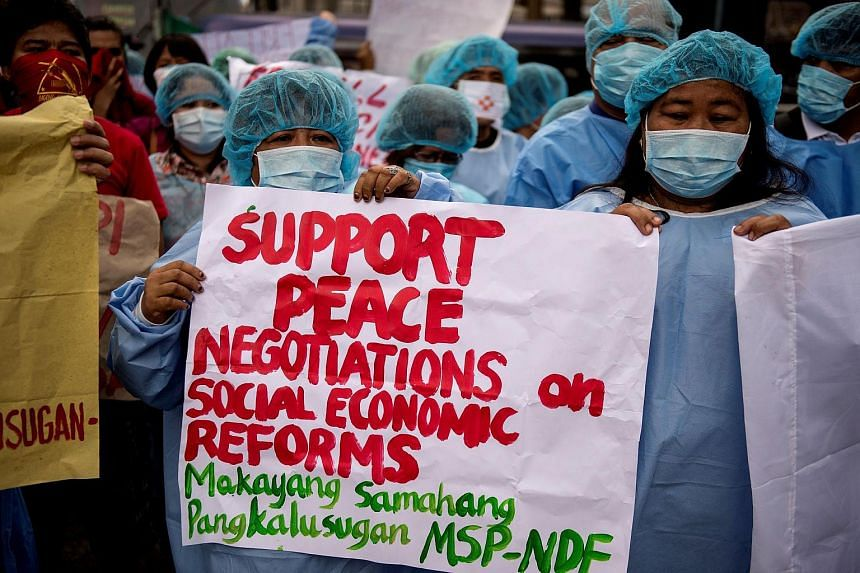 Members of the National Democratic Front of the Philippines (NDFP) hold a demonstration calling for peace negotiations and social economic reforms in Manila.