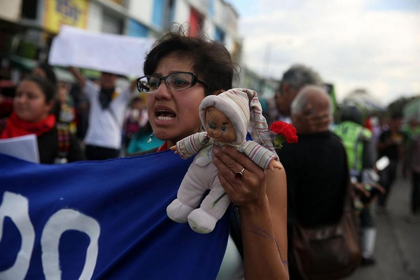 Protestors demanding justice for Guatemalan teens who were abused and died in a fire at a government-run shelter at National Palace in Guatemala City, Guatemala.