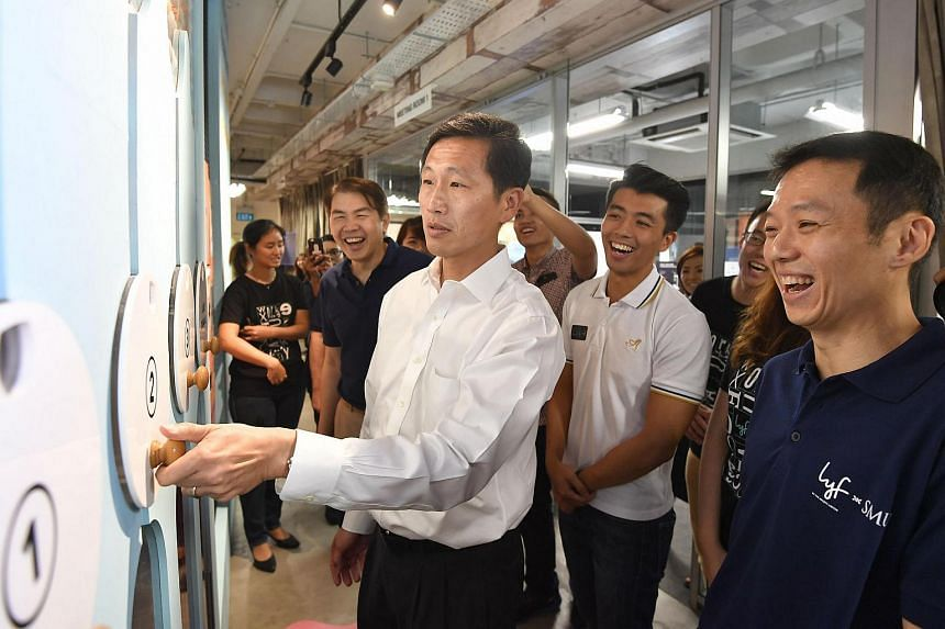 Education Minister (Higher Education and Skills) Ong Ye Kung casting his vote for the lyf@SMU co-living concept room design.