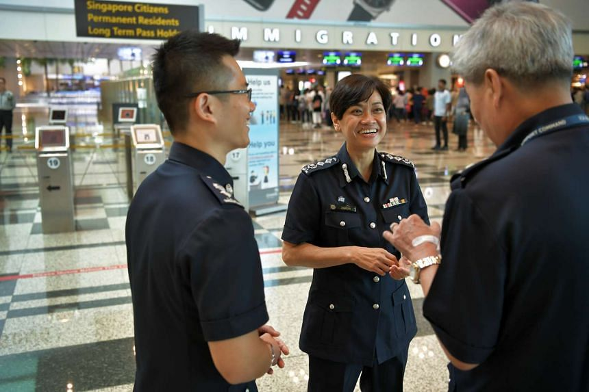 Ms Zuraidah (seen here with ICA officers) feels that in times of heightened alert, security has to take precedence over the airport's reputation for efficiency. She hopes travellers will understand and cooperate.