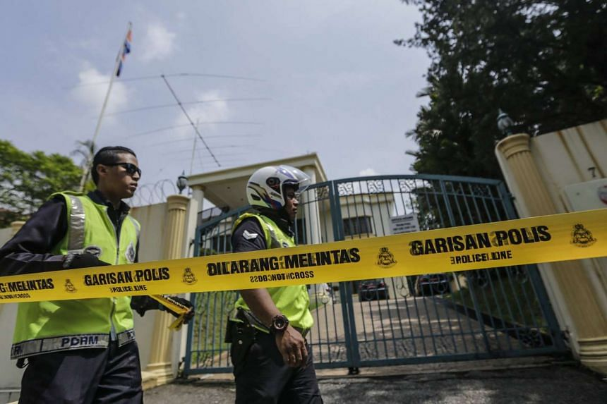 Malaysian police standing behind a cordon at the main entrance to the North Korean Embassy in Kuala Lumpur, on March 7, 2017.