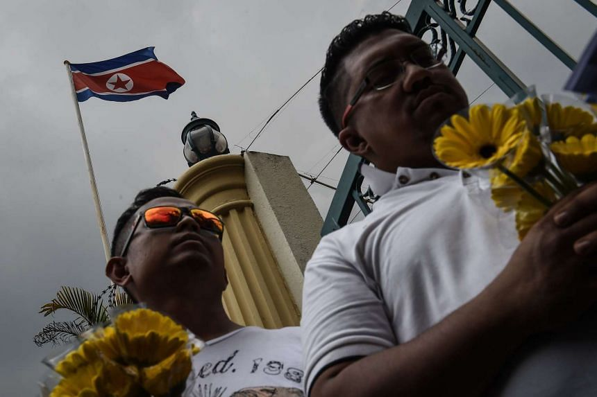 Members of a Malaysian youth NGO calling for peace and diplomatic cooperation outside the gates of the North Korean embassy in Kuala Lumpur on March 10, 2017.