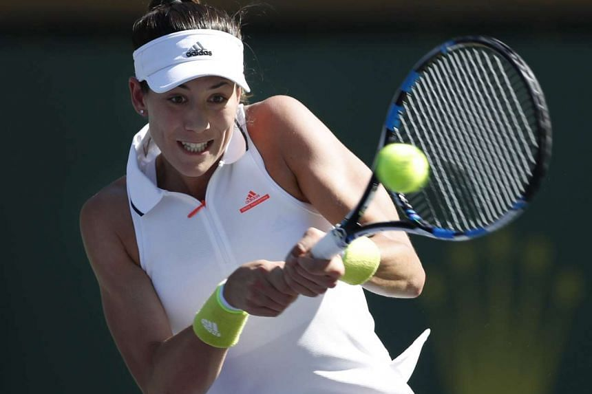 Garbine Muguruza of Spain in action against Kayla Day of USA, during their match at the 2017 BNP Paribas Open tennis tournament at the Indian Wells Tennis Garden in Indian Wells, California, USA, March 12, 2017.