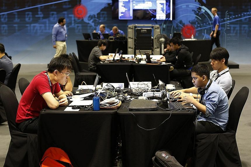 Participants at a cyber challenge event. Experts estimate that there will be more than 10,000 jobs for data protection officers here over the next three years. Such officers ensure that organisations safeguard against the wrongful collection, use and