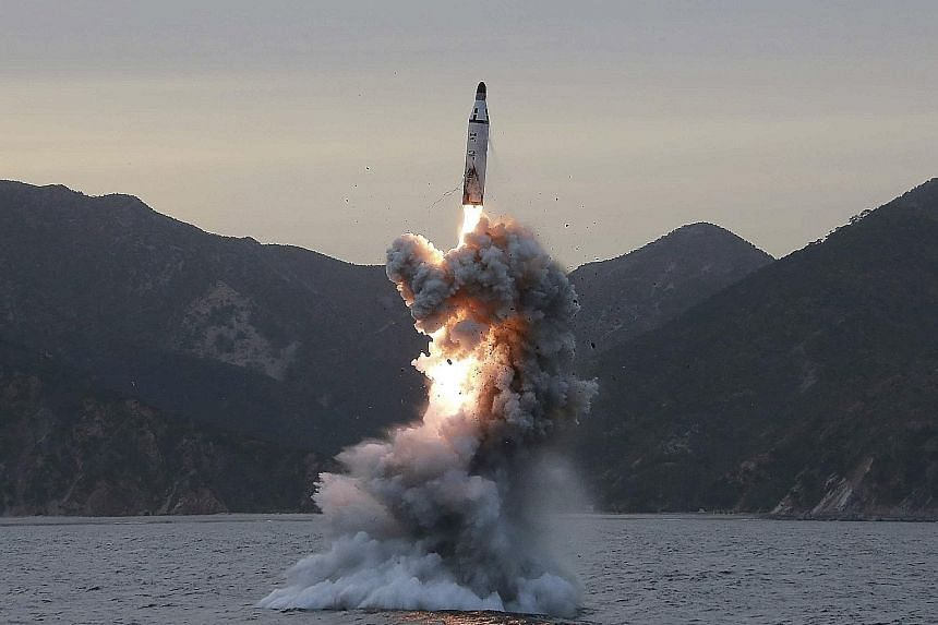 An undated file photo of a submarine ballistic missile being test-fired in an undisclosed location in North Korea.