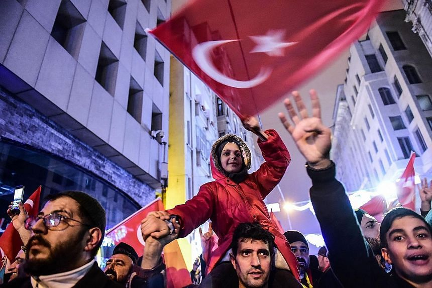 Ms Fatma Betul Sayan Kaya (above) was prevented from addressing a rally in Rotterdam and expelled from the Netherlands. In Istanbul (left), demonstrators staged a protest in front of the Dutch consulate on Saturday.