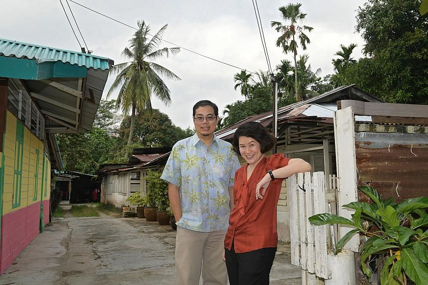 Poet Aaron Lee and writer and teacher Christine Chia, seen here in Kampung Lorong Buangkok, are the editors of a local poetry anthology commissioned by MOE and tentatively titled Lines Spark Code. Schools can use it to teach practical criticism skill