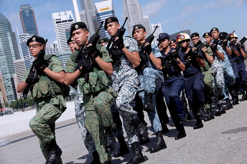 Singapore Armed Forces (SAF) and Home Team personnel during a media briefing for the 2012 National Day Parade (NDP).