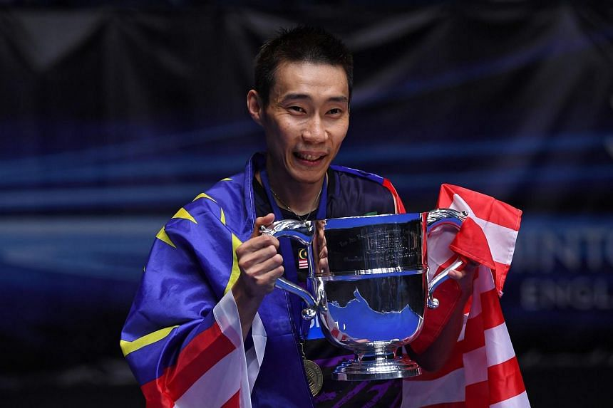 Lee Chong Wei posing with his trophy after beating China's Lin Dan in their All England Open Badminton Championships in Birmingham, central England.